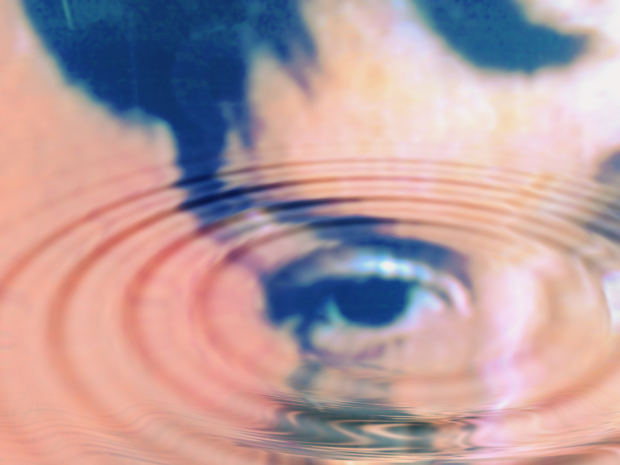 eye reflection in water with wave ripple