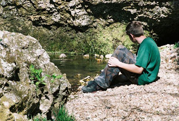 boy-alone-pond-side